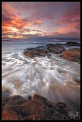Pacific Sunrise (OhYo) Tags: cliff beach nature clouds sunrise canon landscape haystack pacificcity kiwanda 1635l 5d2 vosplusbellesphotos