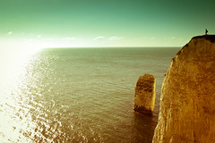 World's Edge (Old Harry Rocks), Dorset [Cross Processed] (flatworldsedge) Tags: old sea sunlight chalk rocks alone glow cross turquoise horizon harry experiment dorset figure vista overexposed cp nationaltrust processed clipping harsh chemical unnatural lr3 lightroom3 yahoo:yourpictures=landscape yahoo:yourpictures=england2013