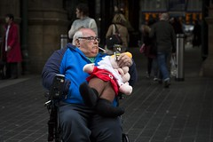 The Gnome (Leanne Boulton) Tags: urban street candid portrait portraiture streetphotography candidstreetphotography candidportrait streetportrait streetlife old man male face facial expression look emotion feeling colourful wheelchair disabled smoke smoker smoking cigarette gnome cuddly toy stuffed cartoon tone texture detail depthoffield bokeh naturallight outdoor light shade shadow city scene human life living humanity society culture people canon canon5d 5dmarkiii 70mm character ef2470mmf28liiusm color colour glasgow scotland uk