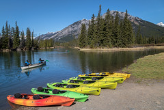 Bow River canoes in Banff (NoVice87) Tags: canada alberta banff canoes river bowriver firtrees