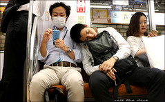 `2010 (roll the dice) Tags: japan japanese tokyo pasmo streetphotography metro subway transport travel passengers portrait candid strangers mad sad fun funny surreal people natural fareast phone iphone mask canon tourism tourists bored sleep yen shintu culture manners polite art classic fashion clean flu cold mobile talk