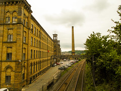 221-  Saltaire - Salts Mill next to railway (1 of 1) (md2399photos) Tags: 2jun17 almshouses davidhockney robertspark saltaire saltaireunitedreformedchurch saltsmill victoriahall