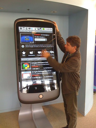 A giant working model of the nexus one phone at a trade show