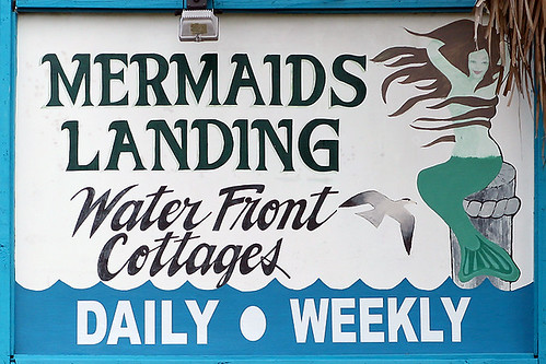 Mermaids Landing Water Front Cottages Sign