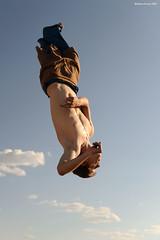 Sky Twist (naturalturn) Tags: shirtless usa man michael jump jumping nevada trampoline burningman blackrockcity esplanade leap 2009 leaping burningman2009 image:rating=4 image:id=080726