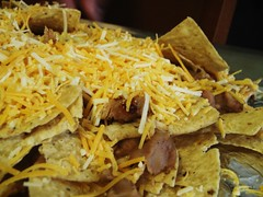 16 - fondue party - nachos with cheese, beans, bacon, chicken