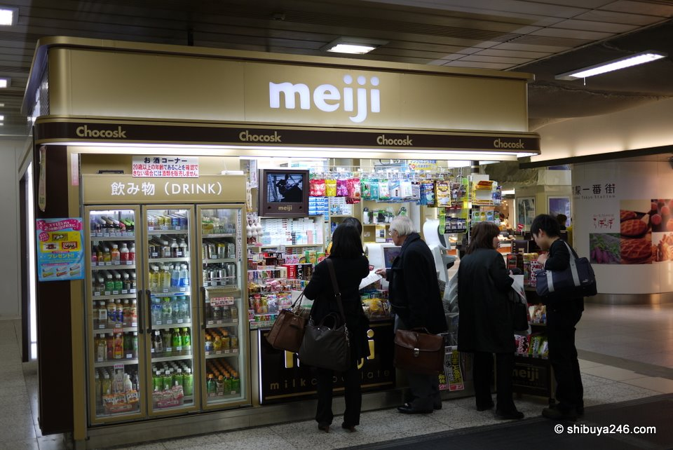"From the front the meiji banner is very prominent where normally you see the words ""kiosk"". Everything else looks like a normal station kiosk."