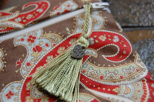 Tassle and Charm on Zipper Bag