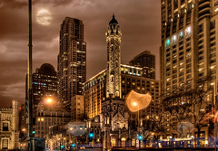 Chicago Water Tower - HDR at night (Mister Joe) Tags: street old city sky urban moon chicago tower water night clouds skyscraper buildings dark lights illinois nikon downtown traffic loop watertower joe gritty michiganave structure historic multiple glowing michiganavenue chicagoloop hdr downtownchicago lucis oldchicago chicagomoon photomatix d80 chicagohistory oldchicagowatertower misterjoe historicchicago iconicchicago chicagostreetsatnight historicwatertowerchicago
