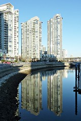 Reflections at False Creek (dons projects) Tags: city blue sun canada reflection building water glass sunshine skyline architecture vancouver buildings reflections lumix downtown cityscape bc cityscapes sunny bluesky streetscene panasonic highrise falsecreek february condos spiegelung vancouverbc condominium 2010 photoscape zs3