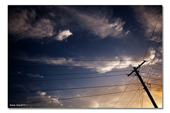 Double Parking is so Gangstar! ([ Kane ]) Tags: sunset sky white home yellow clouds contrast photography hands dusk fluffy australia pole wires qld queensland kane gledhill sigma1020 kanegledhill wwwhumanhabitscomau kanegledhillphotography