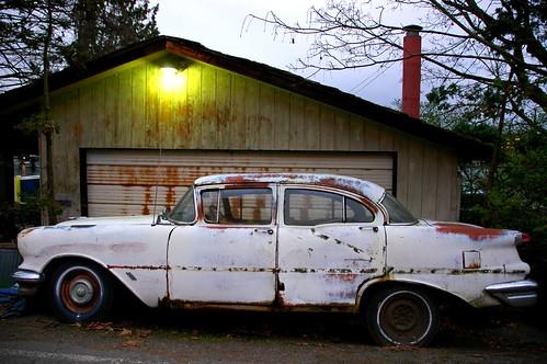Oldsmobile, Rusty, white car, south side of the Montlake Cut, Seattle, Washington, USA by Wonderlane