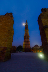 Full Moon at Qutab (Tarun Chopra) Tags: travel india green heritage nature architecture canon geotagged photography asia wizard delhi 7d greatshot gps dslr fx gurgaon complex purchase bharat newdelhi qutubminar touristattractions photograpy qutabminar qutab olddelhi mehrauli canoncamera 0812 nicecomposition hindustan greatcapture indiaimages traveltoindia superbshot alaidarwaza superbphotography canon1022mmlens fantasticimage betterphotography d700 discoverindia makemytrip canonefs1022mmf3545usmlens hindusthan 2470mmf28g earthasia smartphotography canon7d alaigate mustseeindia indiatravelphotography oldmonaments discoveryindia buyimagesofindia hindustanhistoryindiaislammehrauliminarminaretmonumentmughalmuslimn1newnewdelhinikonoldqutabqutabminarqutbqutubrobalesolmetatowerunescoworldheritagesiteuttarpradeshyoungrobv gurugram