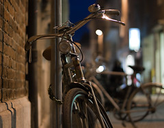 biciclette (i k o) Tags: bicycle canon geotagged eos lights dof nightshot bokeh rimini bici luci riflessi nocturne ef50mmf18ii nighthawk notturno centrostorico reflexes biciclette 800iso 450d nottambulo theauthorsplaza