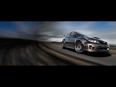 2011-Subaru-Impreza-WRX-STI-4-door-Speed-Front-Angle-1280x960