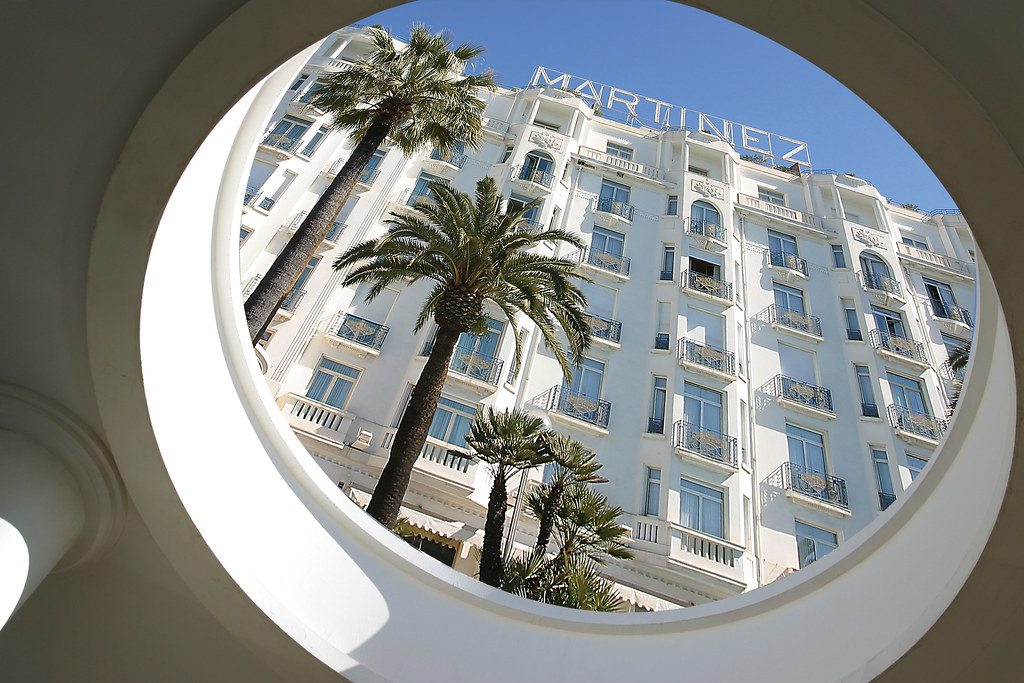 Angle shot under a circular architecture of the Facade of the architecture of Hotel Martinez in Cannes