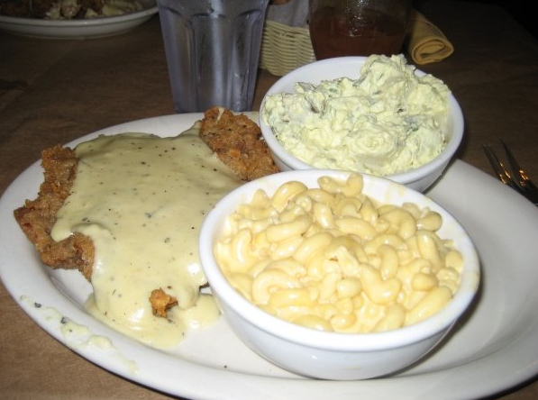 Chicken fried steak with mac n cheese and potato salad