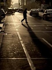 golden wanderings (mugley) Tags: road street city morning urban man blur colour cars 120 mamiya film silhouette mediumformat walking prime 645 glare fuji crossing dof traffic bokeh citylife australia melbourne pedestrian victoria scan negative busy telephoto epson cbd rushhour backlit gutter asphalt 6x45 uphill bitumen reala mamiya645 urbanlandscape lowsun longshadows whitelines keepclear c41 latrobest v700 humanfigure directionallight mamiya645protl m645 fujicolorsuperiareala100 210mmf4sekorc gettyreject