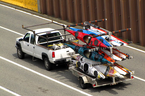 Pickup truck with a laod of canoes in the back going to Vancouver Island