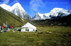 Ramche camp and mountains, Ramche, Kanchenjunga expedition (sanjayausta) Tags: pictures nepal mountain snow mountains 2004 expedition army climb melting indian adventure photographs glaciers third nepalese peaks himalayas sanjay himalayan climbers sherpas highest mountaineers kanchenjunga austa