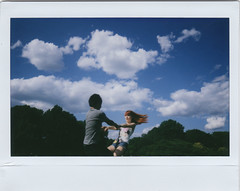 day 7 - nyc (Emily Tebbetts) Tags: park new york nyc trees red summer sky anna love film nature weather june kids youth clouds hair fun polaroid outside happy spring emily pretty fuji wind action spin central young photographers happiness adventure teen monika instant fujifilm vien rodriguez instax tebbetts balazy otebemo szczekutowicz