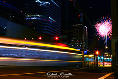 Speeding Towards Celebration. (rslhc) Tags: longexposure urban phoenix night canon subway colorful downtown publictransportation fireworks nighttime motionblur masstransit lightrail xsi lighttrail colorsofthenight