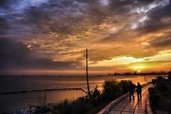 Sunset Promenade (NIKOZAR (Nicola Zaratta)) Tags: sunset canon eos tramonto promenade puglia taranto passeggiata eos50d lumgomare kaunitz2009 asseggiata