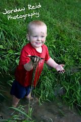 (Jordan Reid Photography) Tags: boy wet water grass creek kid dirty messy muddy