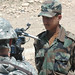 An Afghan National Army trainee is interviewed by Technical Sergeant Michael Tateishi