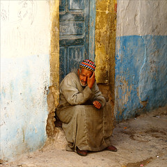 the old man........ (atsjebosma) Tags: street door blue portrait man wall bravo decay oldman explore morocco maroc essaouira oldcity marokko muur straat frontpageexplore abigfave theunforgettablepictures atsjebosma absolutegoldenmasterpiece