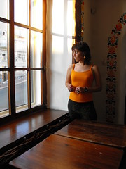 Lena at the window (shotlandka) Tags: wood light shadow portrait orange window girl evening fuji ukraine shade finepix tables fujifilm kiev kyiv киев портрет стол свет тень окно оранжевый девушка вечер украина mywinners s1000fd столы