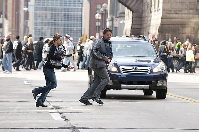 Elizabeth Banks and Russell Crowe make a run for it during 'The Next Three Days'.