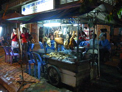 Hot Food Stall, Boulevard Monivong, Phnom Penh (Pigalle) Tags: street city food hot bird shopping asia cambodge cambodia market capital stall meat poultry creativecommons phnompenh takeaway fowl mekong phnom indochine streetmarket penh tonlesap streetstall indochina hotfood kampuchea bassac pearlofasia attributionnoncommercialsharealike ccbyncsa tonlsap phnumpenh phnum phnumpnh