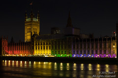 Parliament illuminated for London Pride (The Weekly Bull) Tags: gaypride houseofcommons hypocrisy illumination lgbt london londonpride parliament pinkwash pride rainbowflag riverthames thames westminster westminsterbridge government palaceofwestminster uk nightphotography
