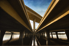 Pythagorean (Lee Sie) Tags: blue sky urban reflection water architecture river concrete nikon traffic sandiego cement overpass onramp freeway intersection column symetry pillars merge chulavista offramp civilengineering d40