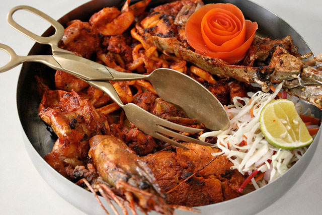 Malabar Seafood Platter - Selection of tiger prawn, fish,  squid, lobster and soft shell crab, pan seared with Kerala marinade