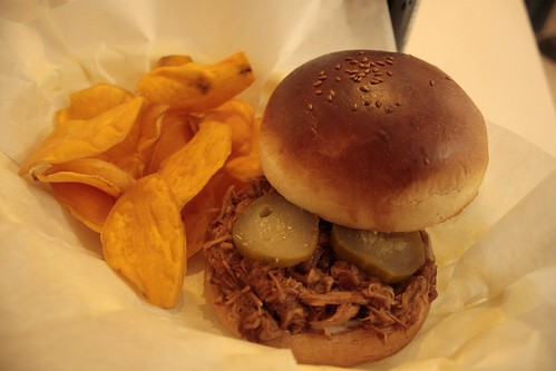 apple braised pulled pork + sesame seed bun + sweet potato chips