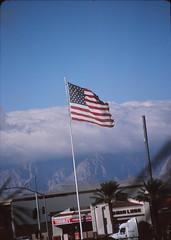 American Flag (Paul_Sch) Tags: winter film 35mm desert wind lasvegas kodak flag nevada dry windy slide 64 photograph american mojave positive kodachrome redrock breeze 2009 pkr mojavedesert