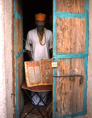 Ethiopian Priest with 1500 year old Bible near Aksum (Puckpics) Tags: life portrait people church pentax pentaxk1000 bible priest ethiopia axum pentaxp30 tigray tigrayprovince