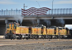 Union Pacific SW1500 1072, followed by MP15DC 1338 and 1342, and GP40-2 1400 pulling a local freight into Tucson (Arizona) yard, January 7, 2010 (Ivan S. Abrams) Tags: railroad chicago phoenix up train losangeles illinois nebraska tucson railway trains unionpacific railways e9 e8 uprr sd402 sw1500 sd40 gp402 sd70m c449w es44ac mp15dc bensonarizona northplattenebraska sybilarizona ivansabrams pimacountyarizona cochisecountyarizona davidsoncanyonarizona lacienegaarizona abramsandmcdanielinternationallawandeconomicdiplomacy ivansabramsarizonaattorney ivansabramsbauniversityofpittsburghjduniversityofpittsburghllmuniversityofarizonainternationallawyer
