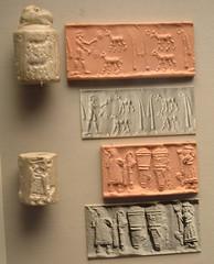 Sumerian Cylinder Seals, British Museum, London [7/9/06] (dizbuster319) Tags: england london museum writing unitedkingdom cylinder seals british artifact cuneiform mesopotamian sumerian