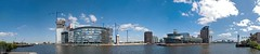 Panoramic view  of Media City UK (jonnywalker) Tags: city uk blue england sky panorama reflection water museum architecture manchester site construction media war apartments skies north engineering salfordquays bluesky panoramic millennium bbc imperial trafford salford quays underconstruction buildingsite lowry imperialwarmuseumnorth manchestershipcanal millenniumfootbridge lowrytheatre mediacity d80 mediacityuk lowryouletmall