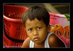 Youth of the Philippines (Sam Antonio Photography) Tags: camera travel boy vacation portrait youth children washingtondc eyes child philippines streetphotography filipino visayas iloilo stockphotography panay portraitphotography canonphotography 5photosaday filipinoyouth iloilocity mywinners canon50d westernvisayas platinumphoto filipinochild tamron18270lens samantoniophotography iloilooldmarket