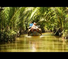a wonderful place.......... (atsjebosma) Tags: people sun nature river boat peaceful vietnam palmtrees mekongdelta canto mekong rivier varen zonnig aquietplace atsjebosma heerlijkrustig passiondclic