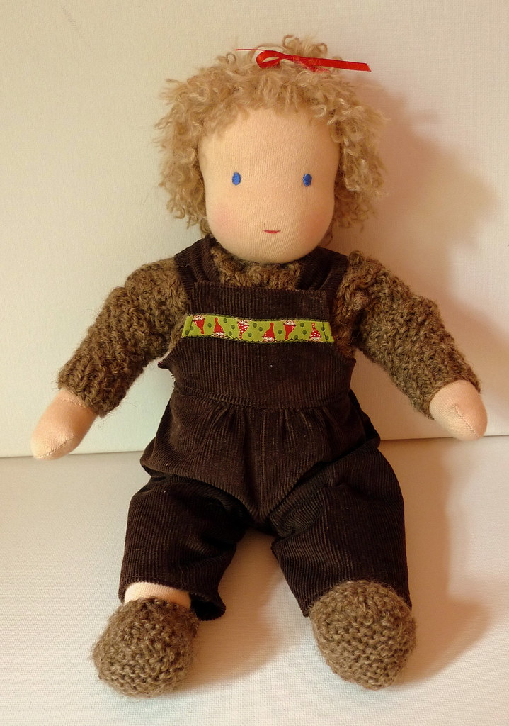 Mia's baby Sally in her corduroy overalls and aran jumper