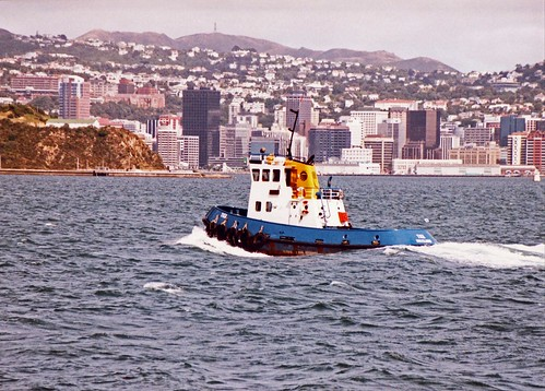 City of Wellington New Zealand 1991 with tug on water