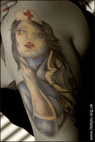 Woman Nurse Tattoo on Female Arm