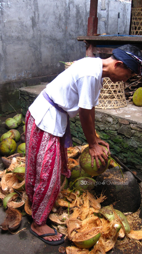 Chief of town preparing coconut water for us