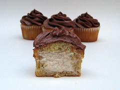 Banana cupcakes with cream filling and chocolate frosting