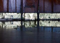 Polish brass. Wet granite. Add sun. (hogsvilleBrit) Tags: door reflection 6ws istanbul symmetry railwaystation rothko symmetrical marble brass haydarpaa sixwordsstory haydarpaagar unusualviewsperspectives haydarpaastation
